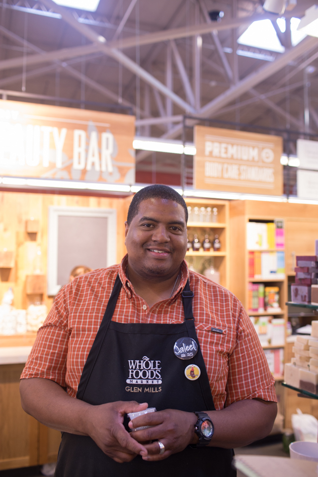 Jaleel McFadden says that he likes working for Whole Foods because he feels a connection with the customers and products there. Credit: Tricia Burrough/Lilac Blossom Photography.