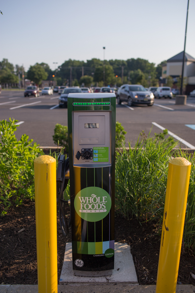 One of a few electric car charging stations in the Cherry Hill Whole Foods parking lot. The station adjoins a rain garden designed to divert runoff from inclement weather. Credit: Tricia Burrough/Lilac Blossom Photography.