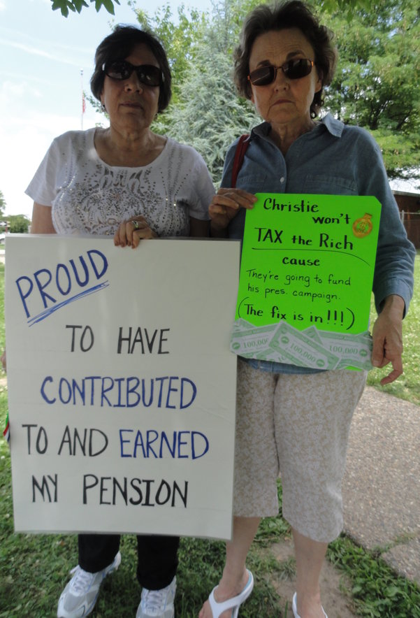 Retired teachers Diane Pliner (left) of Voorhees and Carol Wright of Sicklerville said Christie's reforms short a pension system to which its beneficiaries have made regular contributions. Credit: Matt Skoufalos.