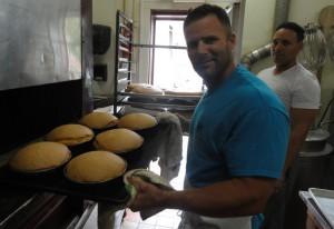 Agigian (left) and DiBartolo, Jr. at work in the kitchen at DiBartolo Bakery in Collingswood. Credit: Matt Skoufalos.