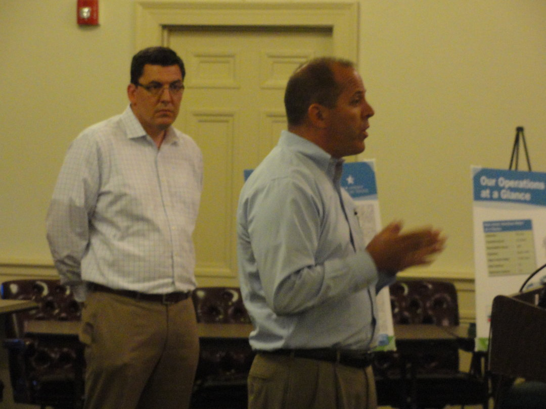 Representatives from New Jersey American Water addressed Haddonfield residents about the proposal to purchase their water and sewer system on Wednesday. Carmen Tierno (right) said there could be staffing changes as a result of the sale. Credit: Matt Skoufalos.