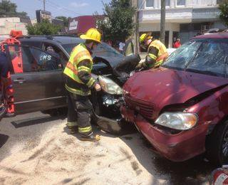 Oaklyn firefighters clean up the road after a three-vehicle accident on the White Horse Pike on Tuesday. Credit: Curt Hudson.