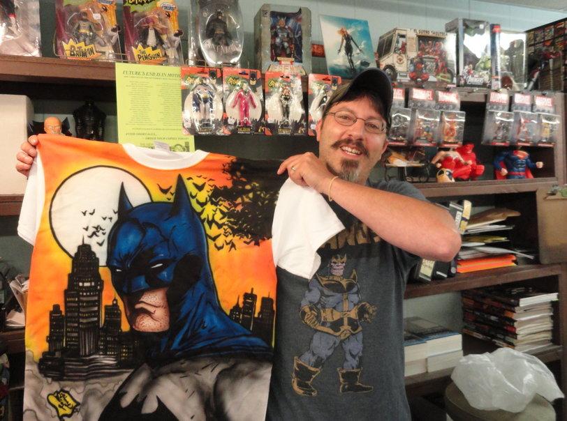 Brian Rappa shows off a custom-made Batman t-shirt at Fat Jack's Comicrypt in Oaklyn. Credit: Matt Skoufalos.