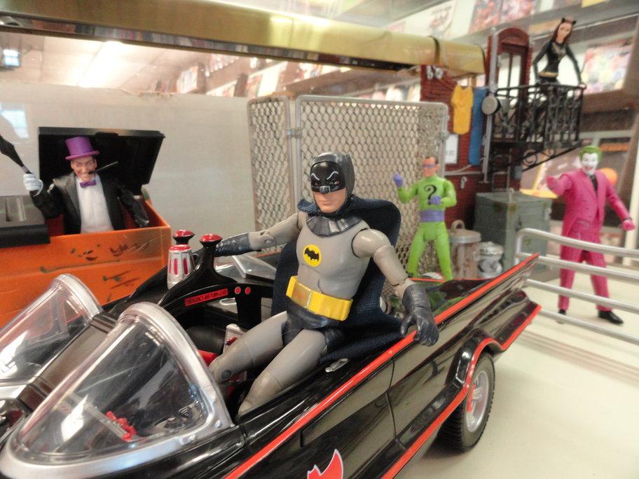 Classic 1960's Adam West Batman toys, on display at Fat Jack's Comicrypt. Credit: Matt Skoufalos.