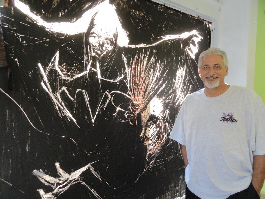 Scott Kaitz with his Batman mural at The Comic Station in Haddon Heights. Credit: Matt Skoufalos.