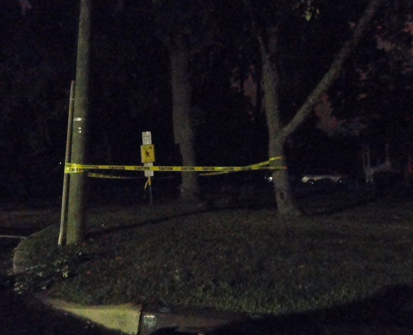 Caution tape surrounds trees on a darkened Shady Lane in Haddon Township during a power outage Tuesday. Credit: Matt Skoufalos.