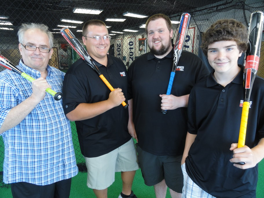 Sports 4 All Owner John Vrana (left) is joined by employees Pat Domin, 23, Mike Moser, 23,  and Alex Tessing, 15, all of Haddon Township.