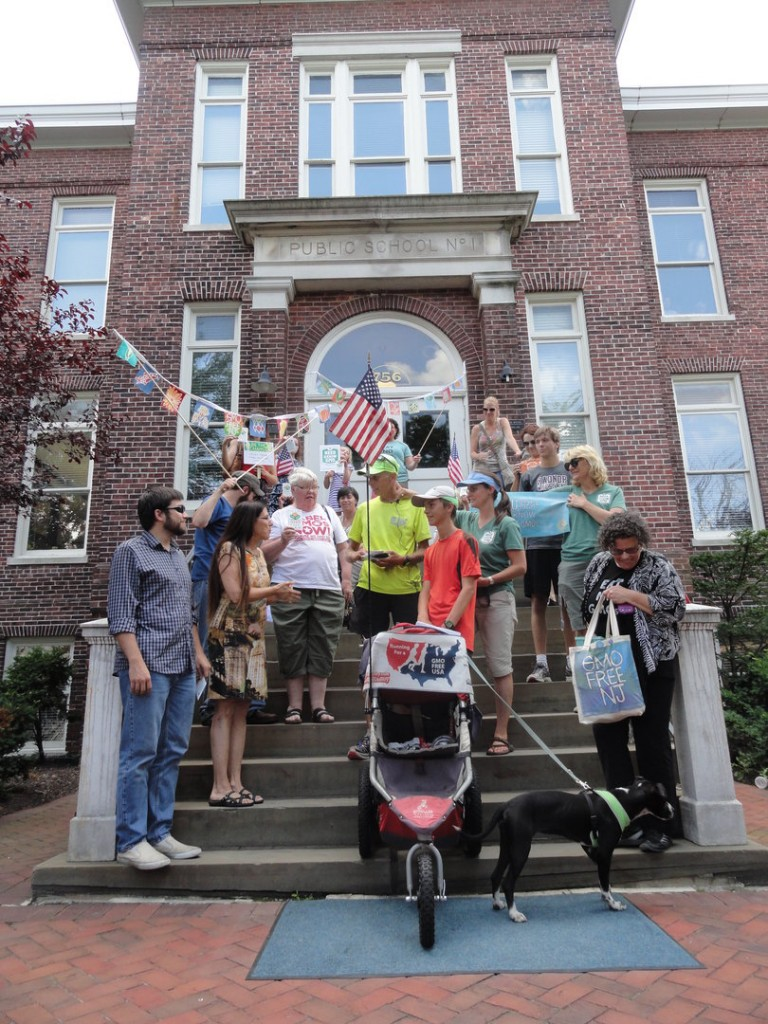 A crowd of supporters from GMO Free NJ joins Collingswood Commissioner Joan Leonard in greeting the Wilcox family on their 3,000-mile run. Credit: Matt Skoufalos
