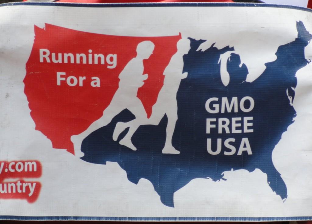 The GMO Free USA banner that adorns the Wilcox family jogging stroller. Credit: Matt Skoufalos.