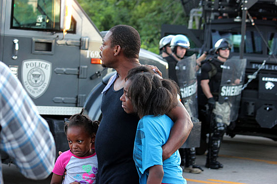 Onlookers approach the police lineup in Ferguson, MO on Wednesday. Police in Ferguson, MO, brace for a clash with residents of the town on Wednesday. Credit: Danny Wicentowski / Riverfront Times.