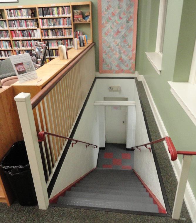 The bathroom in the basement of the Haddonfield library is accessible only by these steps, currently, Credit: Matt Skoufalos,