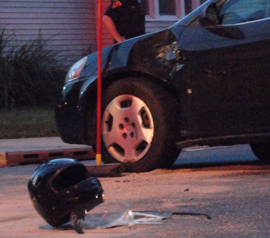 The sedan's front end was damaged by the impact, but the motorcyclist's helmet remained intact. Credit: Matt Skoufalos.
