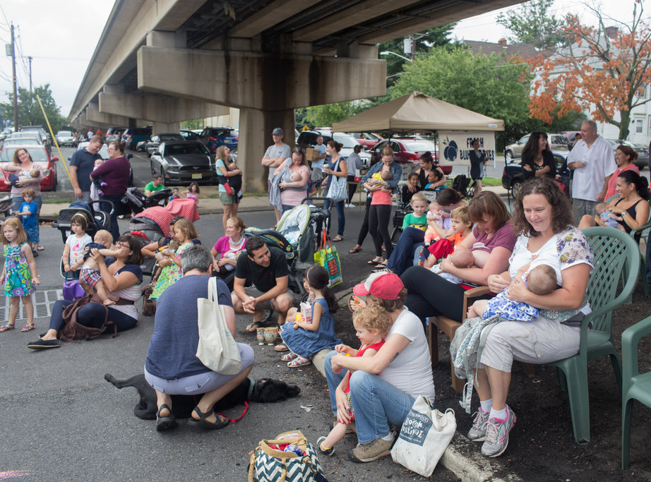 Some 15 moms and babies held a symbolic breastfeeding 'latch-on' Saturday at the Collingswood Farmers Market. Credit: Tricia Burrough & Lilac Blossom Photography.
