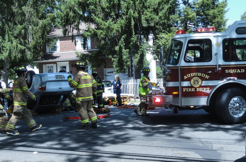 Members of the Audubon and Mt. Ephraim Fire Departments removed the door of the driver's Ford Focus to rescue her from the wreck. Credit: Matt Skoufalos.