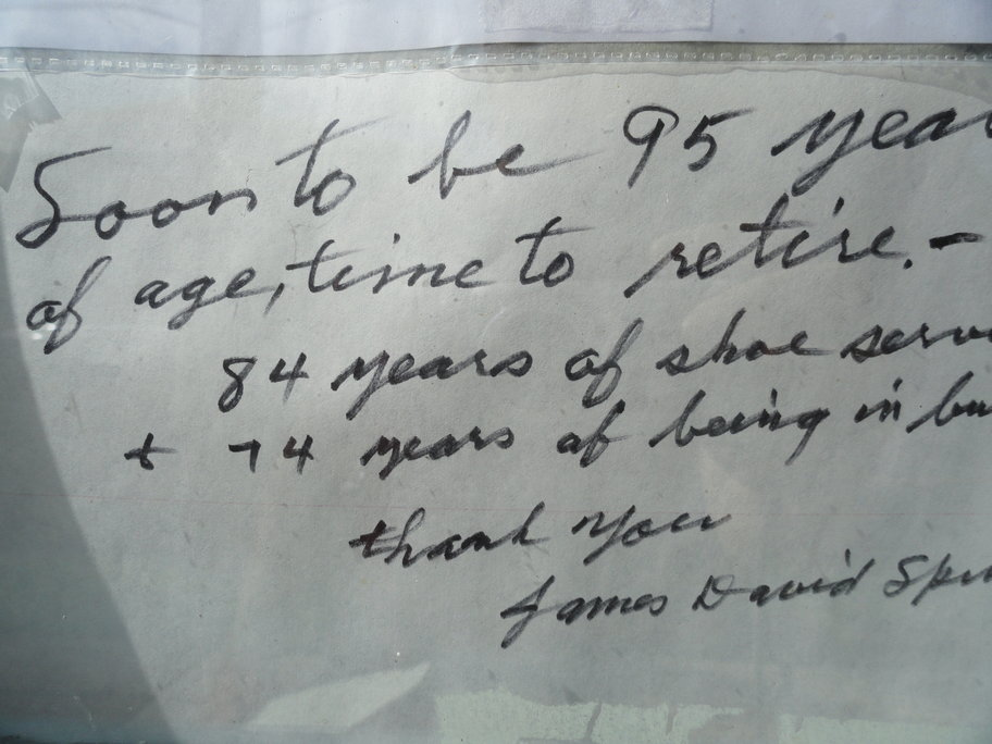 The handwritten farewell note from Spinelli that hangs in the window of Quaker Shoe Repair. Credit: Matt Skoufalos.