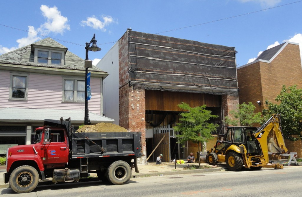 Construction vehicles help excavate and re-pour the foundation at the entrance to the DePace Sports Museum on Haddon Avenue in Collingswood. Credit: Matt Skoufalos.