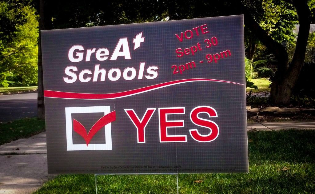 A sign encouraging voters to approve the Haddon Twp. bond referendum. Credit: Matt Skoufalos.