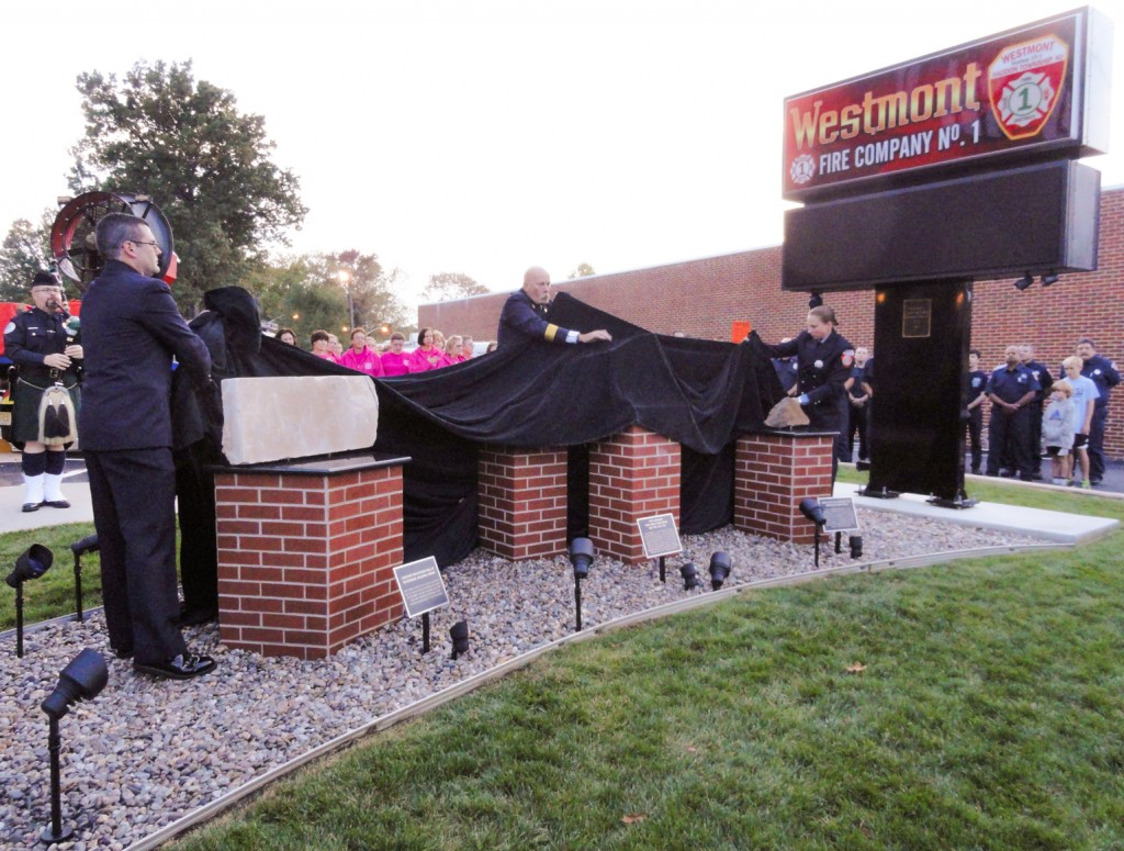 Gallagher, Voigtsburger, and Hauber unveil the Westmont Fire Company's 9-11 Memorial. Credit: Matt Skoufalos.