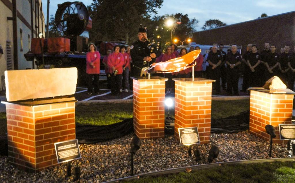 The sun descends on the 9-11 Memorial dedication in Westmont. Credit: Matt Skoufalos.