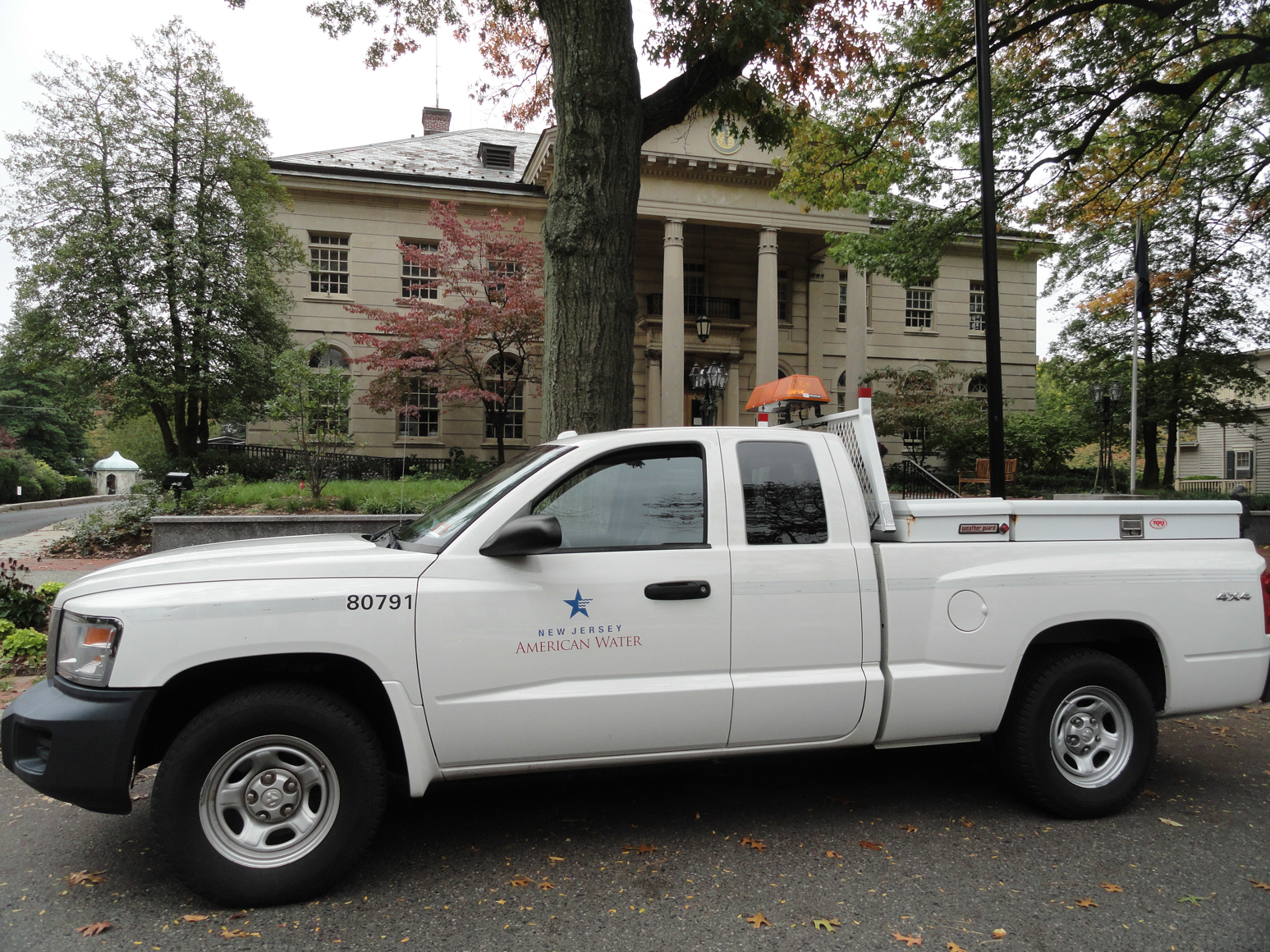 A New Jersey American Water vehicle parked outside of Haddonfield borough hall. Credit: Matt Skoufalos.