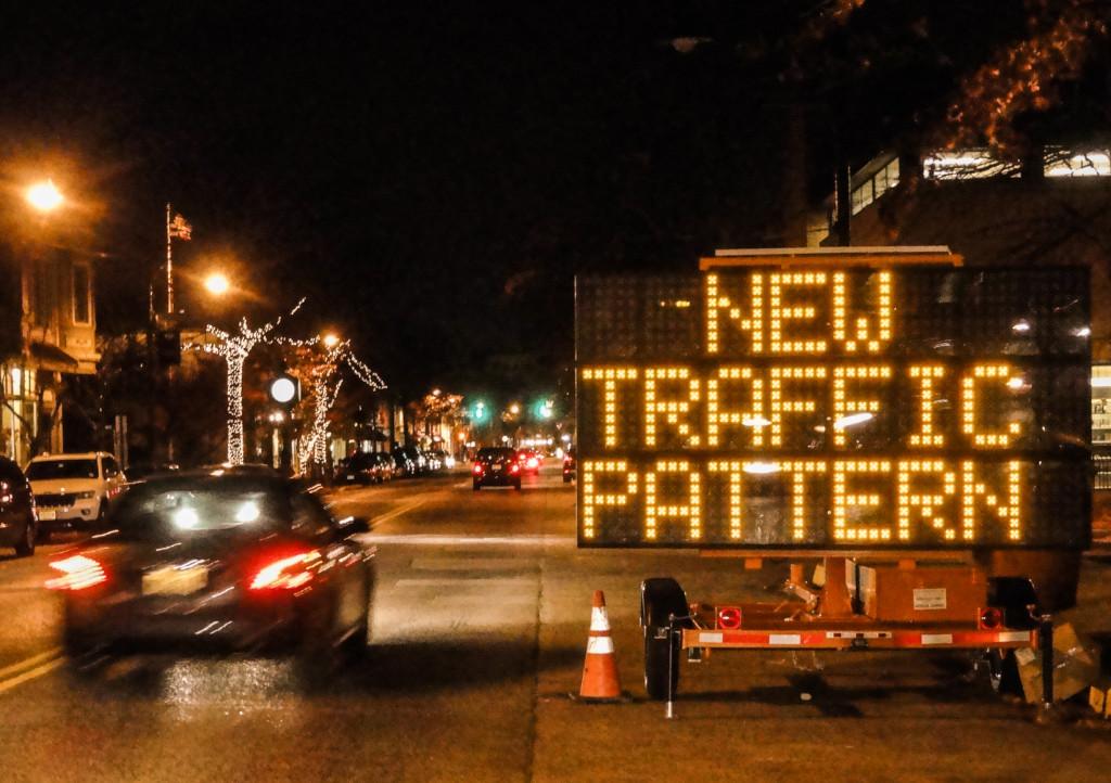 Traffic signs alert drivers to the new median. Credit: Matt Skoufalos.