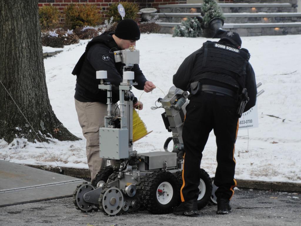 Camden County Bomb Unit officers prepare a tactical robot. Credit: Matt Skoufalos.