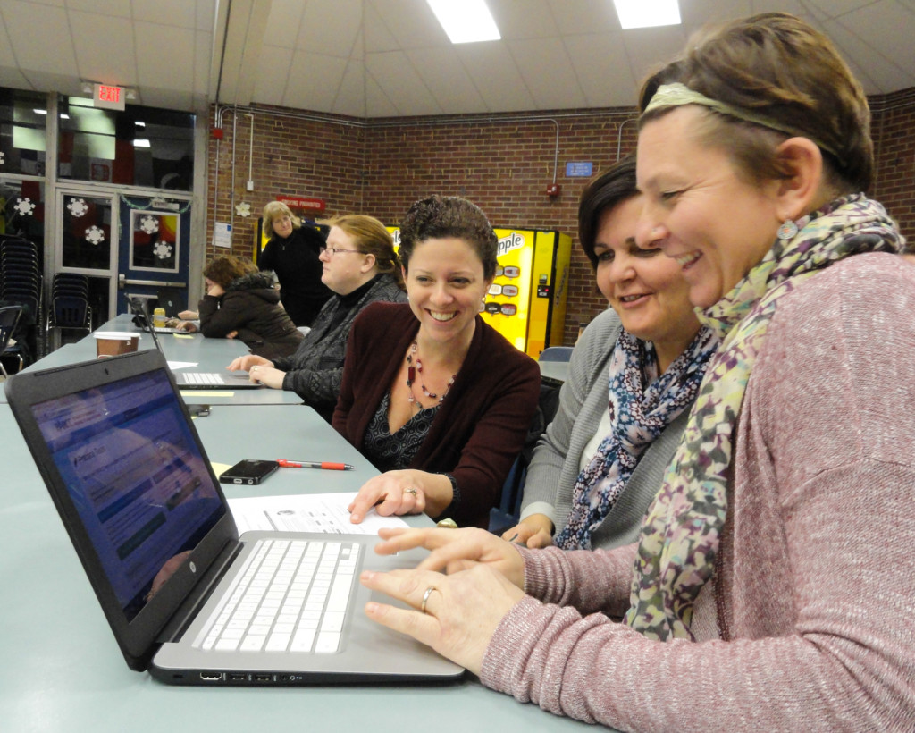 Collingswood parents try out the PARCC. Credit: Matt Skoufalos.