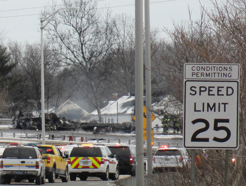 An overturned fuel truck burns in Pennsauken. Credit: Matt Skoufalos.