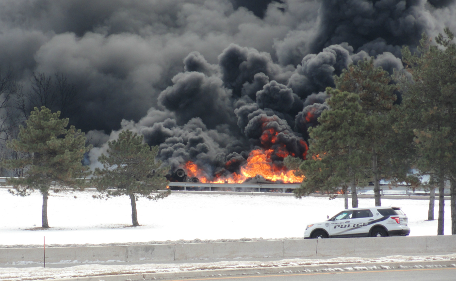 Fire at the foot of the Betsy Ross Bridge. Credit: Matt Skoufalos.