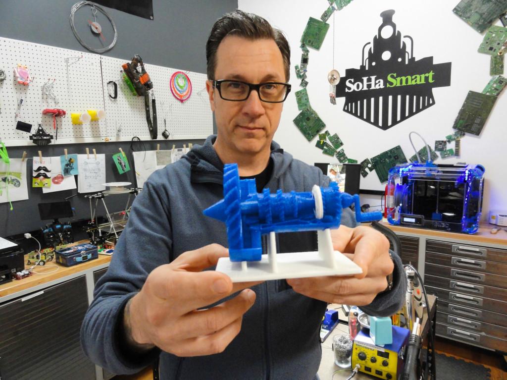 Lavon Phillips shows off some 3D printed tech. Credit: Matt Skoufalos.
