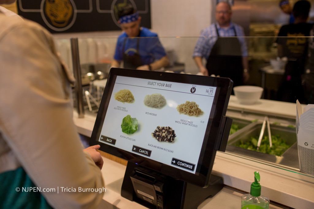 Touchscreen ordering at Honeygrow Cherry Hill. Credit: Tricia Burrough.