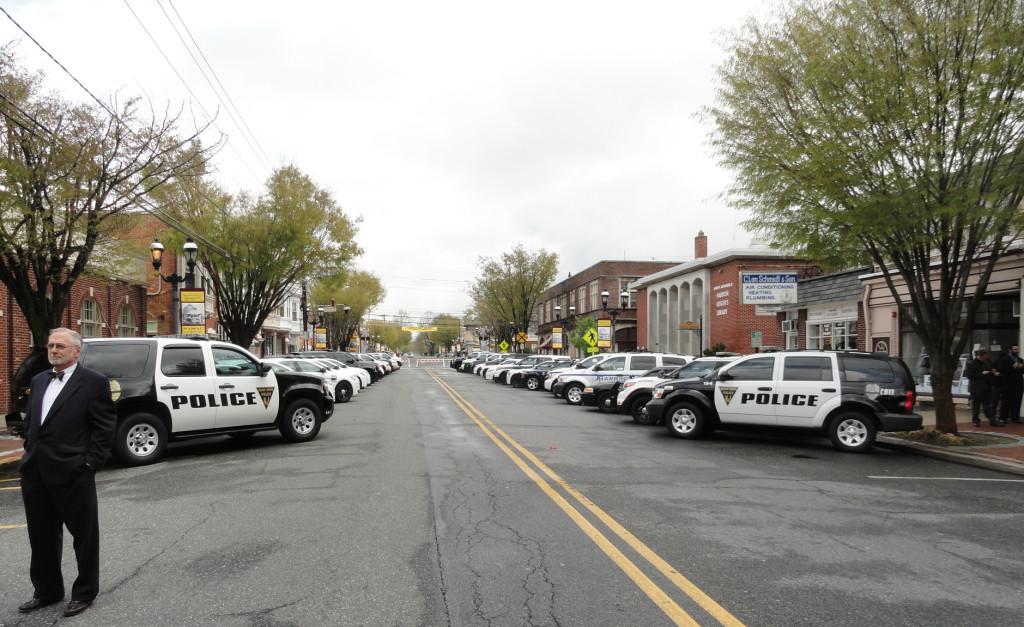Row of police vehicles in  Haddon Heights. Credit: Matt Skoufalos.