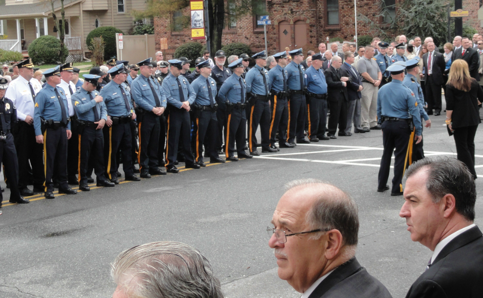 Police line the streets of Haddon Heights in a memorial for fallen officers John Norcross and James McLaughlin. Credit: Matt Skoufalos.