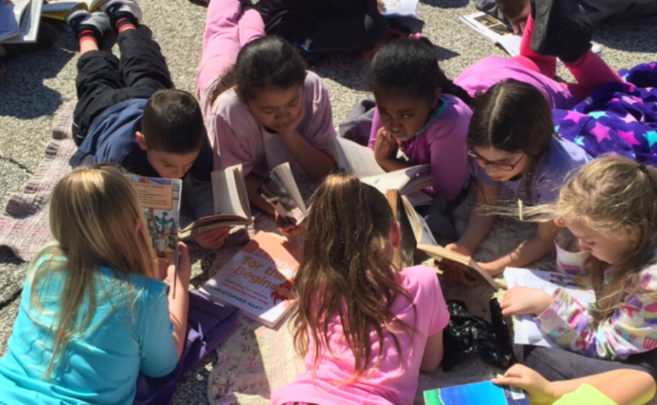 Students reading outside at Merchantville School