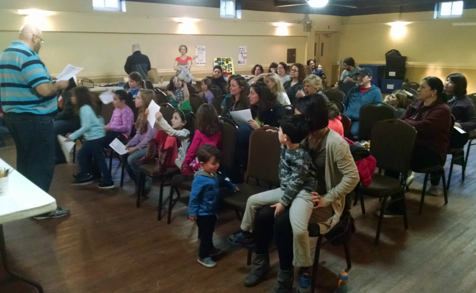 Girl Scouts and family gathered in the basement of the Oaklyn Baptist Church to hear about living with disability from their neighbors. Credit: Matt Skoufalos.