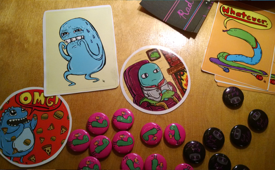 Angerstein is merchandising his characters in a variety of ways from stickers to pins and original artwork. Credit: Matt Skoufalos.