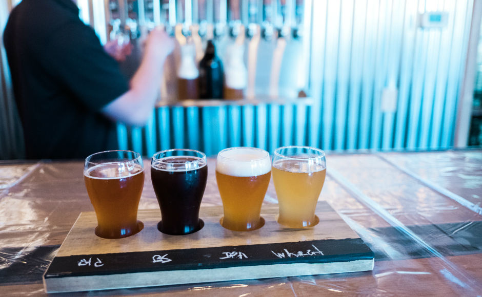 The inaugural Devil's Creek flight includes the 1888 Old Ale, Mandarin IPA, Brown Sugar 69 specialty ale, and Ethereal Wheat hefeweissen. Credit: Tricia Burrough.