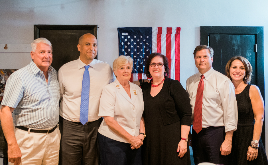 From left: Jack Young, Sen. Cory Booker, Judith Young, Melinda Kane, Rep. Donald Norcross, Assemblywoman Pamela Lampitt. Credit: Tricia Burrough.