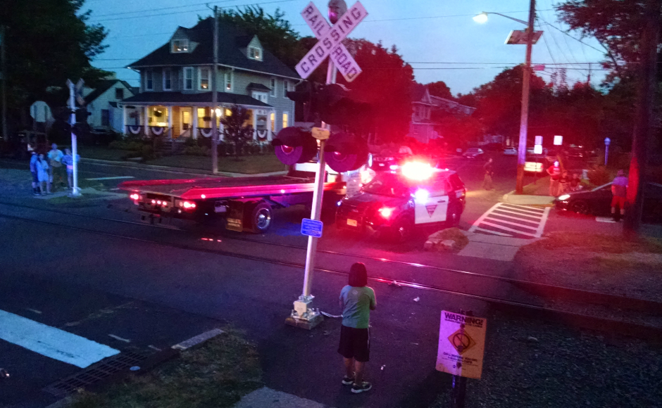 A tow truck prepares to clear the scene of an accident in Audubon. Credit: Matt Skoufalos.