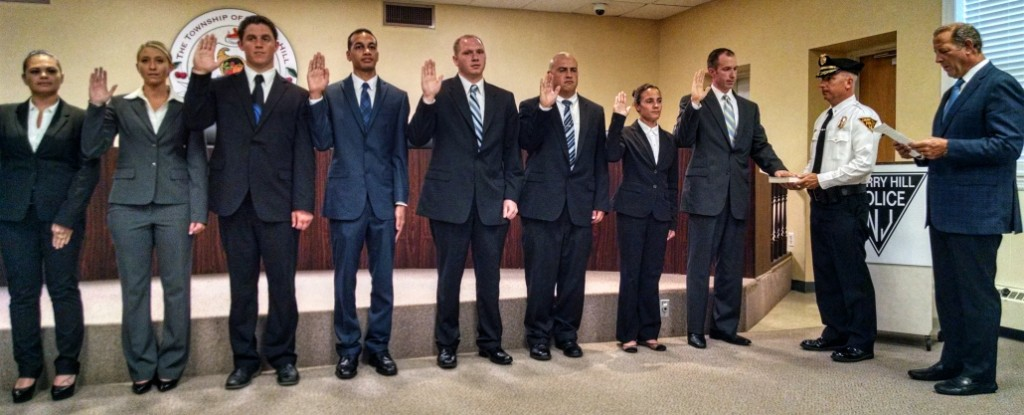 Cherry Hill police recruits take their oaths of office. Credit: Matt Skoufalos.