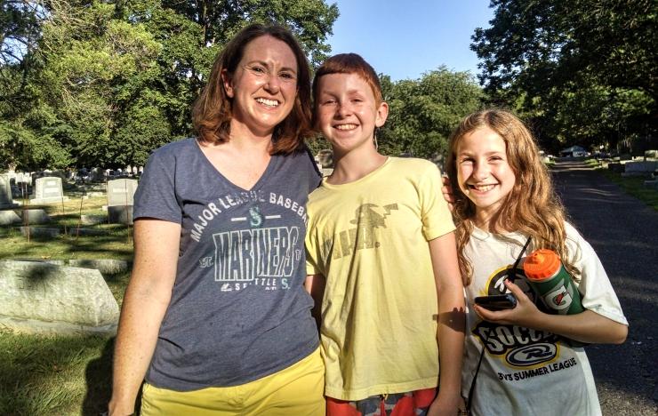 Nancy, Owen, and Sydney Rondeau playing Pokemon Go in the Haddonfield Baptist Cemetery. Credit: Matt Skoufalos.
