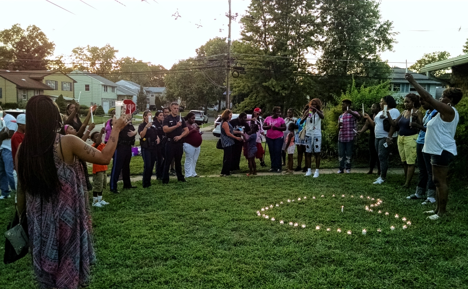 Friends and family lit candles and prayed at a vigil for Jamil Baskerville, Jr. in Pennsauken. Credit: Matt Skoufalos.
