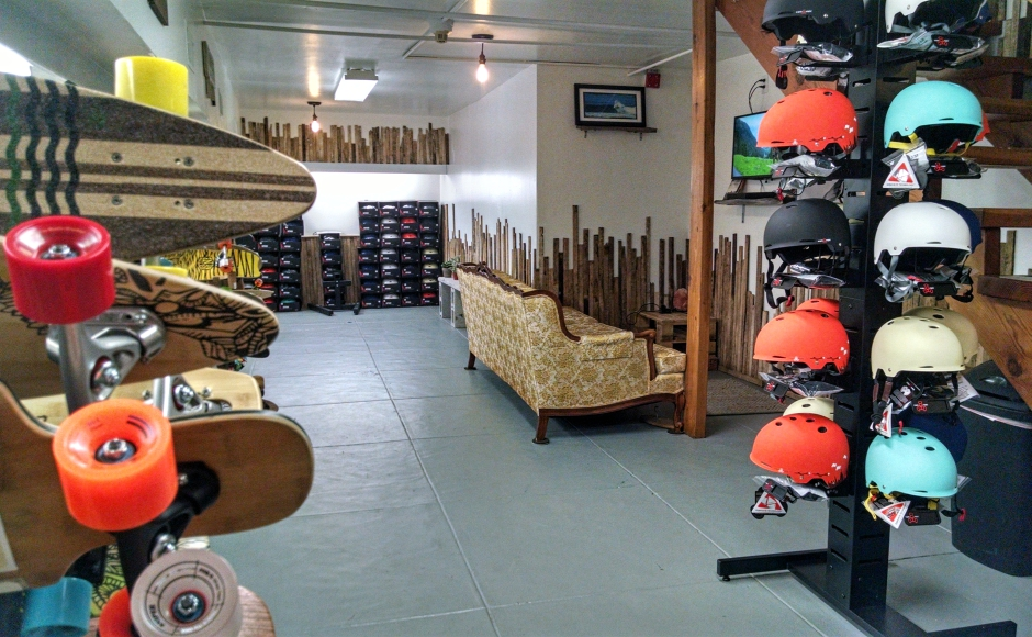 The basement at Community Bikes and Boards is given over to skate culture, with a viewing lounge and gear. Credit: Matt Skoufalos.