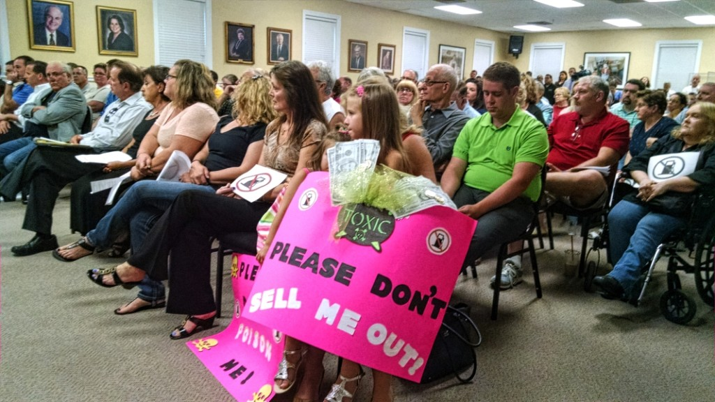 Residents protest a zoning change at a Cherry Hill Council meeting. Credit: Matt Skoufalos.