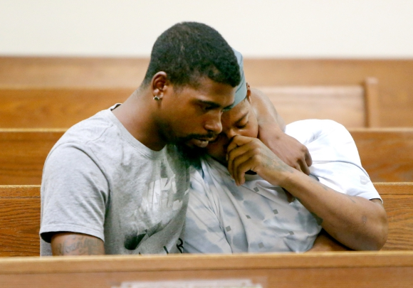 Bo Baskerville, left, and his brother Jamire, comfort each other after the arraignment of Zachary Tricoche in the Camden County Hall of Justice, Tuesday, Aug. 23, 2016. Tricoche has been charged with first-degree murder in the beating of their nephew 2-year-old Jamil Baskerville Jr. (Tim Hawk | For NJ.com)