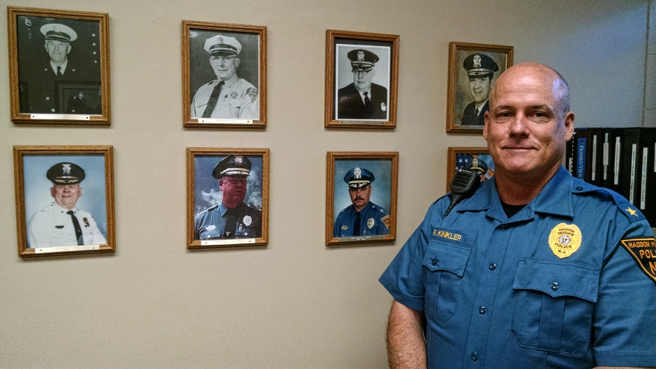 Haddon Heights Police Chief Rich Kinkler stands with his predecessors in the department. Credit: Matt Skoufalos.