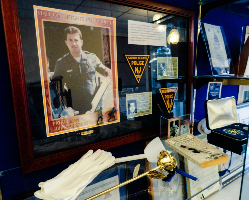 A memorial to fallen officer John Norcross is maintained in the Haddon Heights Municipal Building. Credit: Matt Skoufalos.