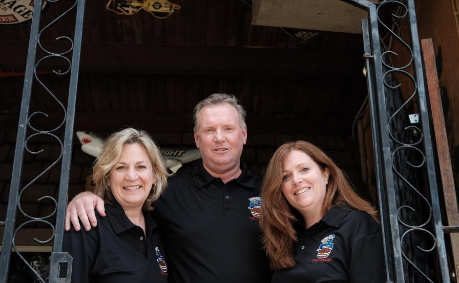 Lisa Del Duke (left), Gary Mullins, and Allison Del Duke on the patio of The Oaklyn Manor. Credit: Tricia Burrough.