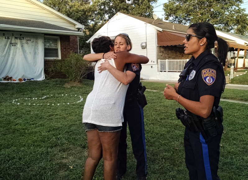 Family embraced Pennsauken Ptl. Nicole Kulyk (left) and Linnette Ramos, the first officers at the scene of the 9-1-1 call. Credit: Matt Skoufalos.