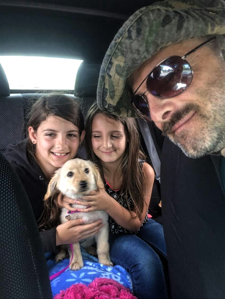 JB Stone and daughters celebrate Roxie's adoption. Credit: Ro Stone.